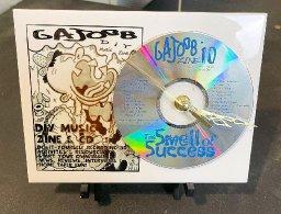 25th Anniversary GAJOOB Magazine's Smell Of Success CD Clock